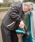 Repairing a broken car mirror. After an act of vandalism in the city (France Royalty Free Stock Photo