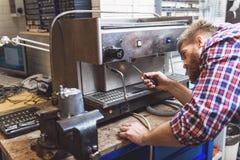 Repairing of broken coffee machine Royalty Free Stock Images