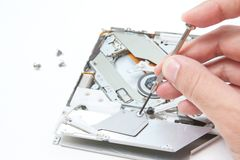 Repairing cd/dvd writer Stock Photography
