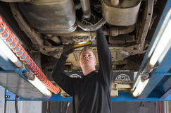 Repairing and checking a car Royalty Free Stock Images