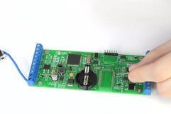 Repairing chip board. Soldering and repairing printed circuit board royalty free stock image