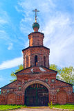 Repairing church of red brick near Yaroslavl Stock Image