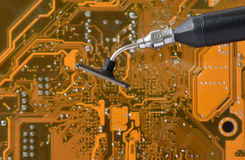 Repairing circuit boards. Repairing on background circuit boards Royalty Free Stock Images