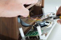 Repairing clock radio Royalty Free Stock Images