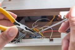 Repairing clock radio Stock Photography