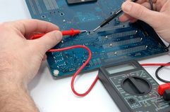 Repairing computer circuit board Stock Photos