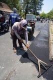 Repairing demaged roads Stock Image