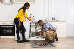 Repairing Dishwasher In Kitchen Royalty Free Stock Images