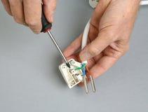 Repairing an electrical plug. stock image