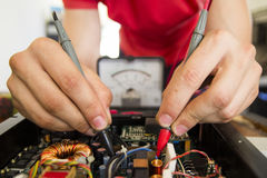 REPAIRING ELECTRONICS WITH TEST EQUIPMENT. IN SERVICE CENTER BY ENGINEER Stock Photography
