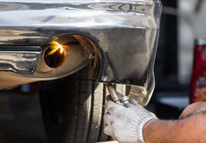 Repairing exhaust pipe. Welders were repairing  cutting exhaust pipe of a car Stock Photos