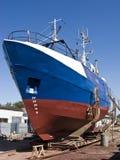Repairing fishing boat stock photos