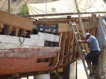 Repairing fishing boat Stock Images