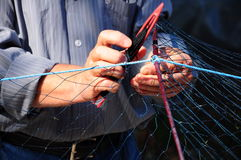 Repairing a fishing net Royalty Free Stock Images