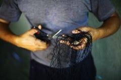Repairing a fishing net Stock Photography