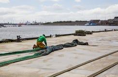 Repairing fishing nets. Stock Photos