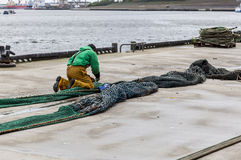 Repairing fishing nets. Royalty Free Stock Photos