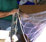 Repairing a fishnet Stock Images
