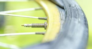 Repairing a flat tire of an bicycle tire. Patched up inner tube. Of an bicycle tire stock image