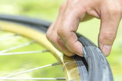 Repairing a flat tire of an bicycle tire. Patched up inner tube. Of an bicycle tire stock photo