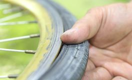 Repairing a flat tire of an bicycle tire. Patched up inner tube stock photography