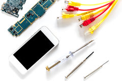 Repairing gadgets. Parts, wires and tools on white background top view Stock Images