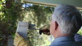 Repairing gate latch stock video