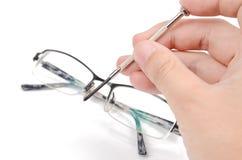 Repairing glasses Royalty Free Stock Images
