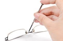 Repairing glasses Stock Photo