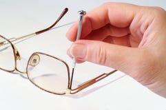 Repairing glasses royalty free stock image