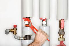 Repairing a heating pipe with gripper Stock Photos