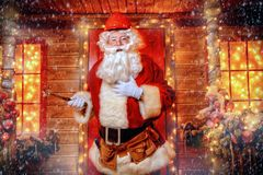 Repairing house santa. Portrait of Santa Claus in helmet repairing his home. Christmas and New Year concept royalty free stock images