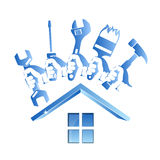 Repairing a house symbol with a tool. Repair a house symbol with a tool for business Stock Images