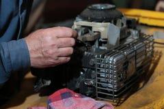 Repairing lawn mower engine Royalty Free Stock Images