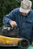 Repairing lawn mower engine Royalty Free Stock Photography