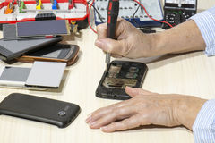 Repairing mobile phone Stock Photo
