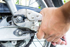 Repairing Motorcycles. Close Up shot Of  Man Repairing Motorcycles Stock Photo