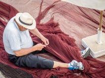 Repairing the nets Stock Photo