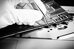 Repairing notebook black and white Stock Photos