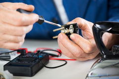 Repairing Old Power Plug Royalty Free Stock Photo