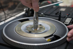 Repairing old vintage turntable vinyl record player. Closeup hands repair and recycling old vintage turntable vinyl record player Royalty Free Stock Photo