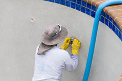 Repairing pool light Stock Images