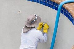 Repairing pool light. Resurfaced Diamond Brite pool plaster detail and new pool light work stock images