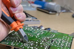 Repairing the power supply of the TV set. Repair the power supply unit of the TV in the service center stock images