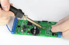 Repairing printed circuit board. Soldering and repairing printed circuit board royalty free stock photo