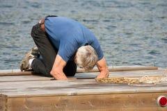 Repairing the raft Stock Images