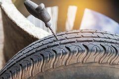 Repairing recap flat car tire for tubeless tires. Royalty Free Stock Photography