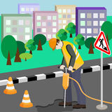 Repairing of the road. Repairman with jackhammer. Repairing of the road in town. Repairman with jackhammer doing his work Royalty Free Stock Images
