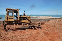 Repairing road and sea breaker in beach near ocean Stock Image