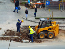 Repairing road, workers Stock Photo